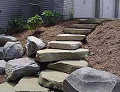 Sandstone Step with Boulder Wall